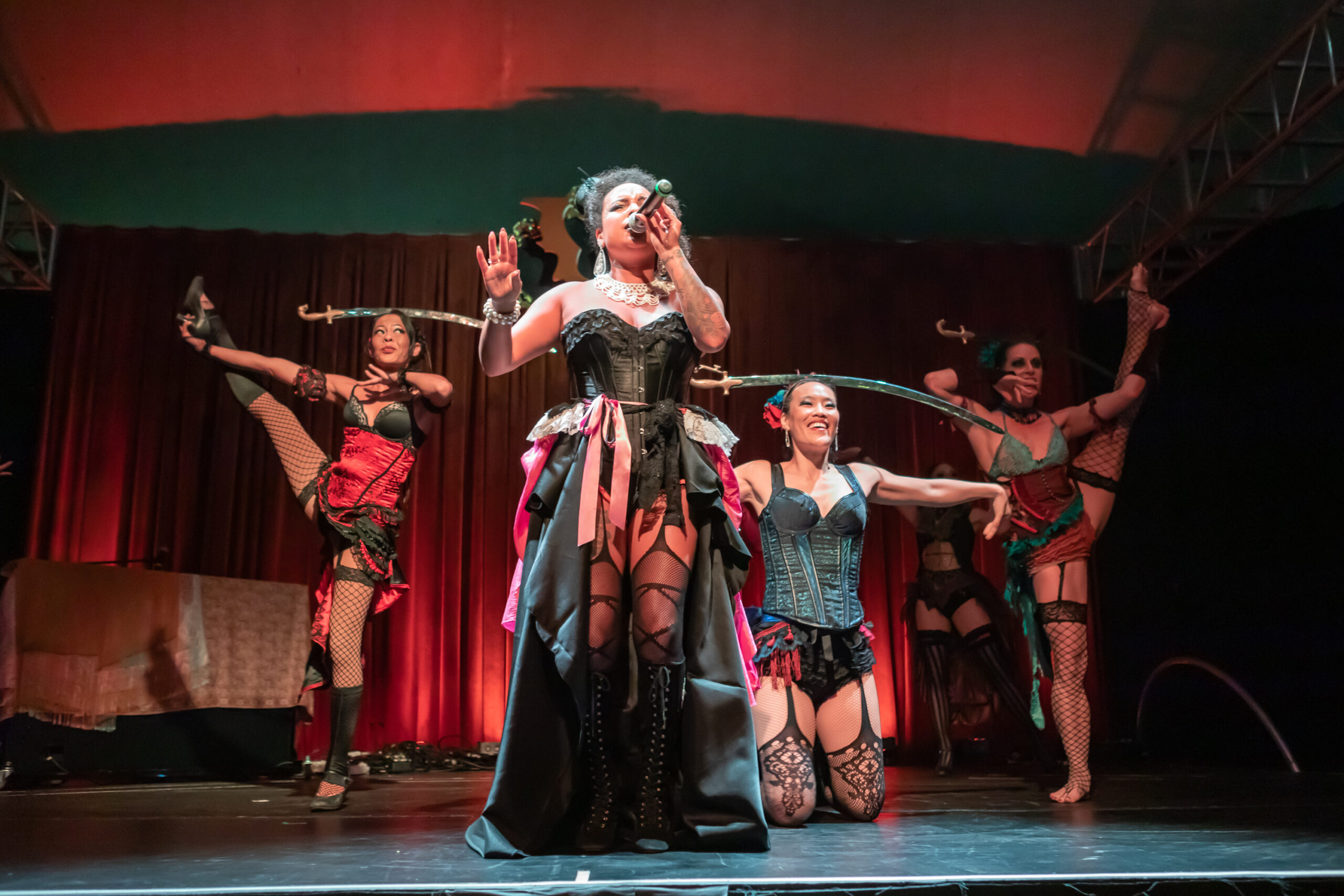 Image of Viveca Hawkins and Vau de Vire Society dancers performing at Vau de Vire's The Soiled Dove dinner theater Under the Tortona Big Top in Downtown Oakland