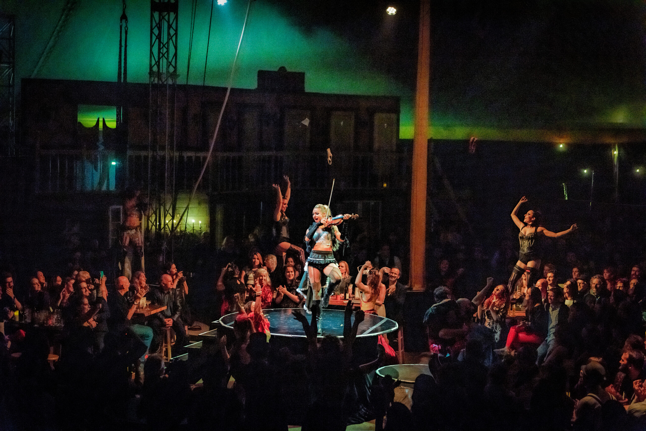 Image of Shaina Evoniuk and Vau de Vire Society performing at Vau de Vire's The Soiled Dove dinner theater Under the Tortona Big Top in Downtown Oakland