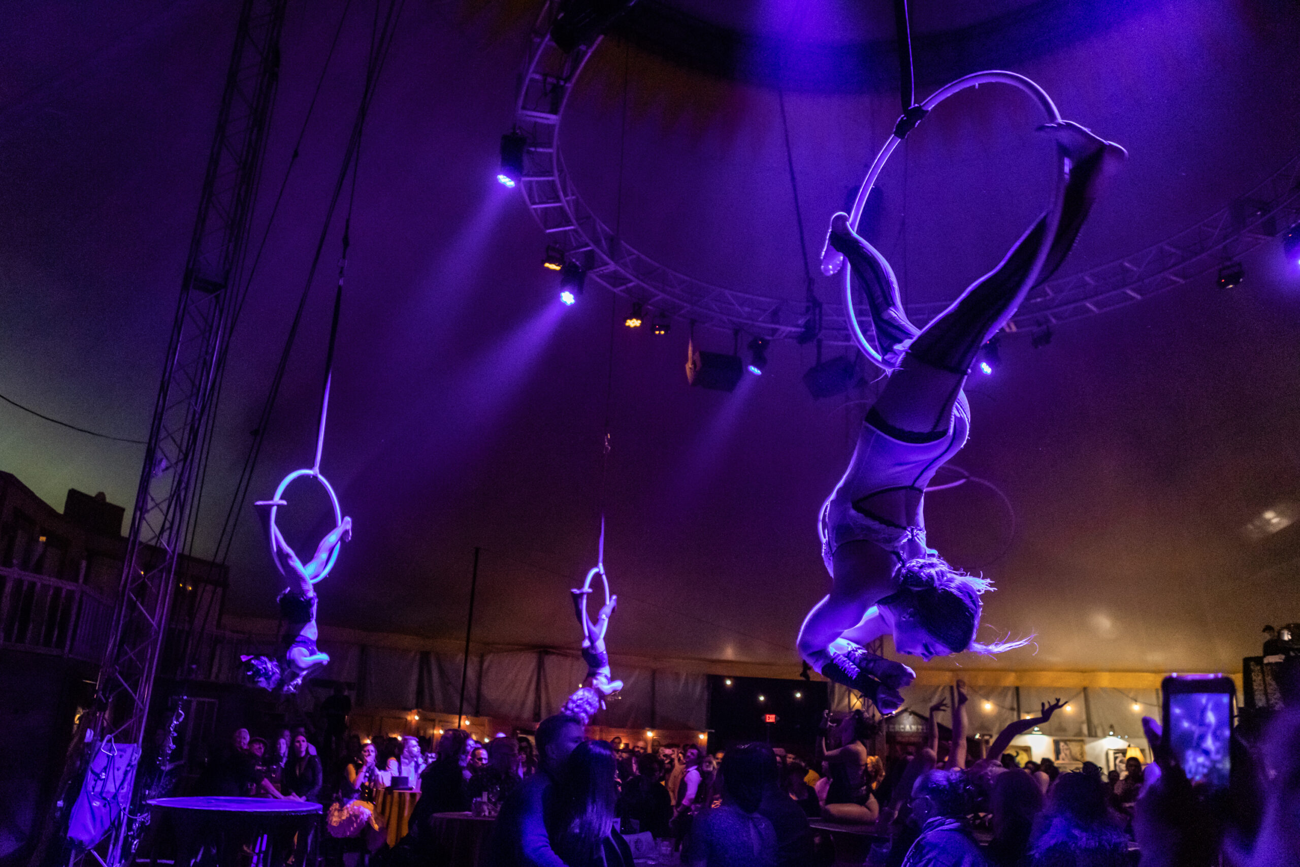 Image of Vau de Vire Society aerialists performing at Vau de Vire's The Soiled Dove dinner theater Under the Tortona Big Top in Downtown Oakland