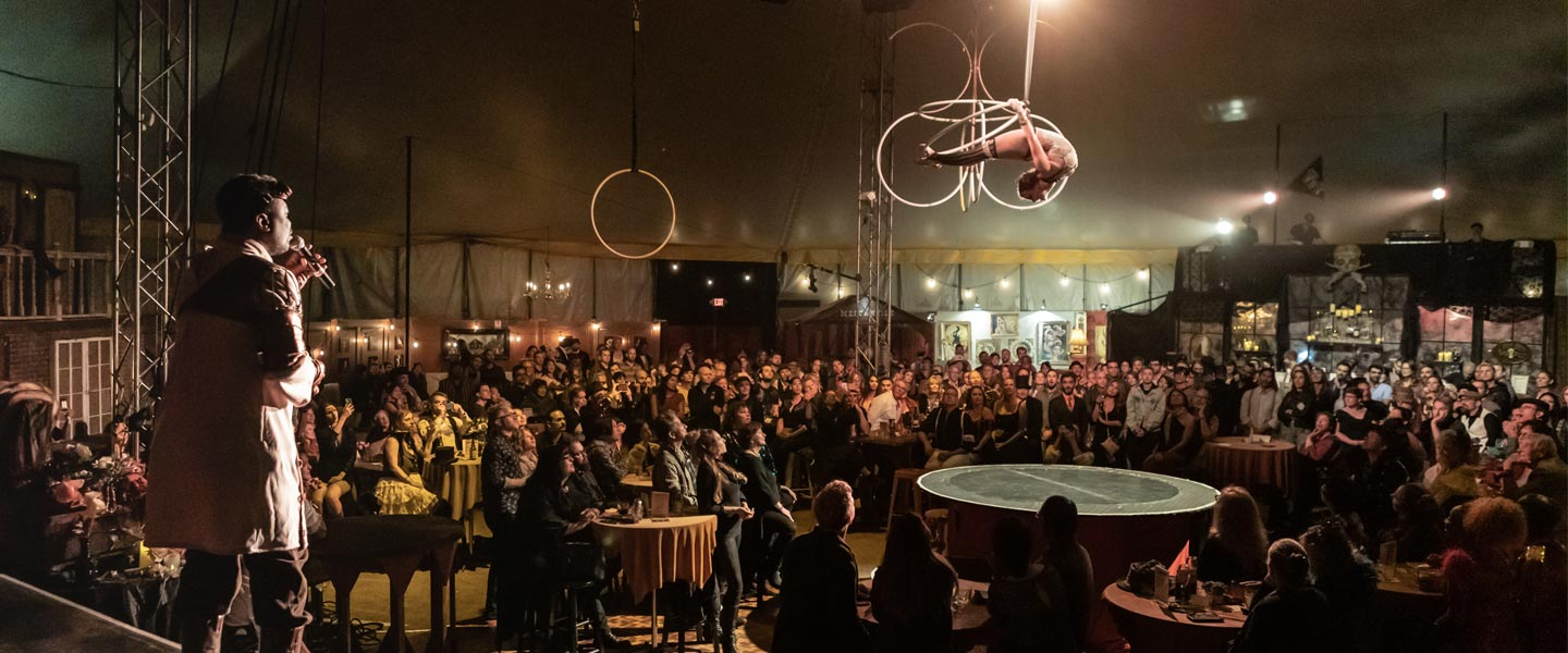 Image of Stephanie Bailey and Trance Thompson performing at Vau de Vire's The Soiled Dove dinner theater Under the Tortona Big Top in Downtown Oakland