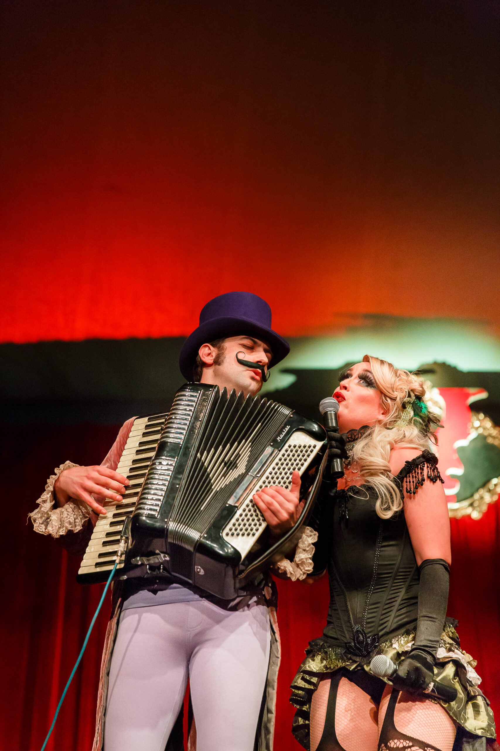 Image of Amelia Van Brunt and Jasper performing at Vau de Vire's The Soiled Dove dinner theater Under the Tortona Big Top in Downtown Oakland